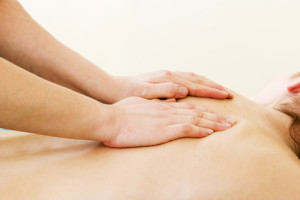 A female receives a shoulder massage at a day spa.